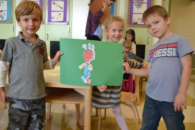 Kindergarten students work on their collaborative monster project.